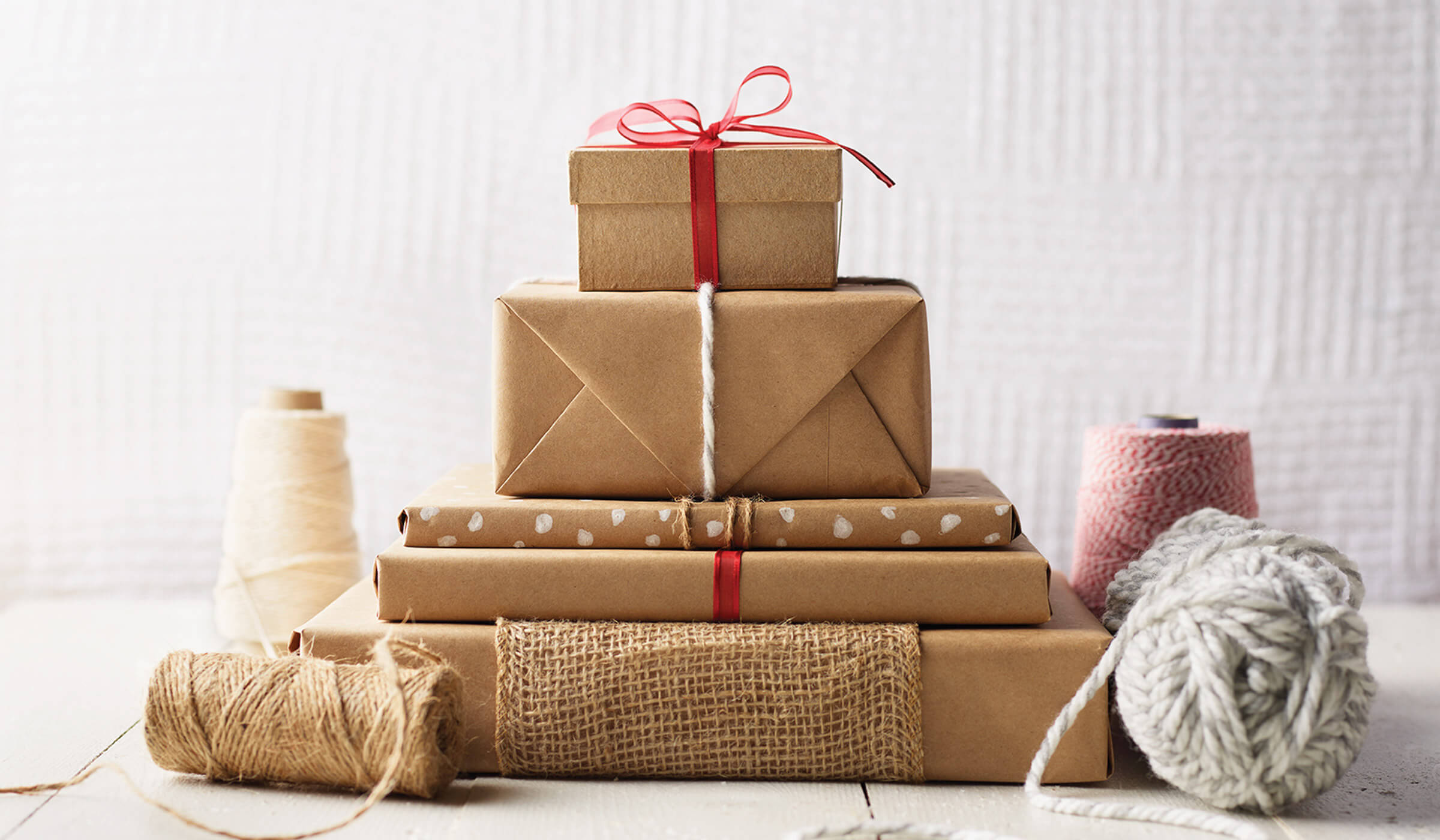 Create A Fun Non Traditional Centerpiece By Wrapping Objects From Around Your Home In Kraft Paper Books Empty Boxes And Pantry Items Are All Fair Game