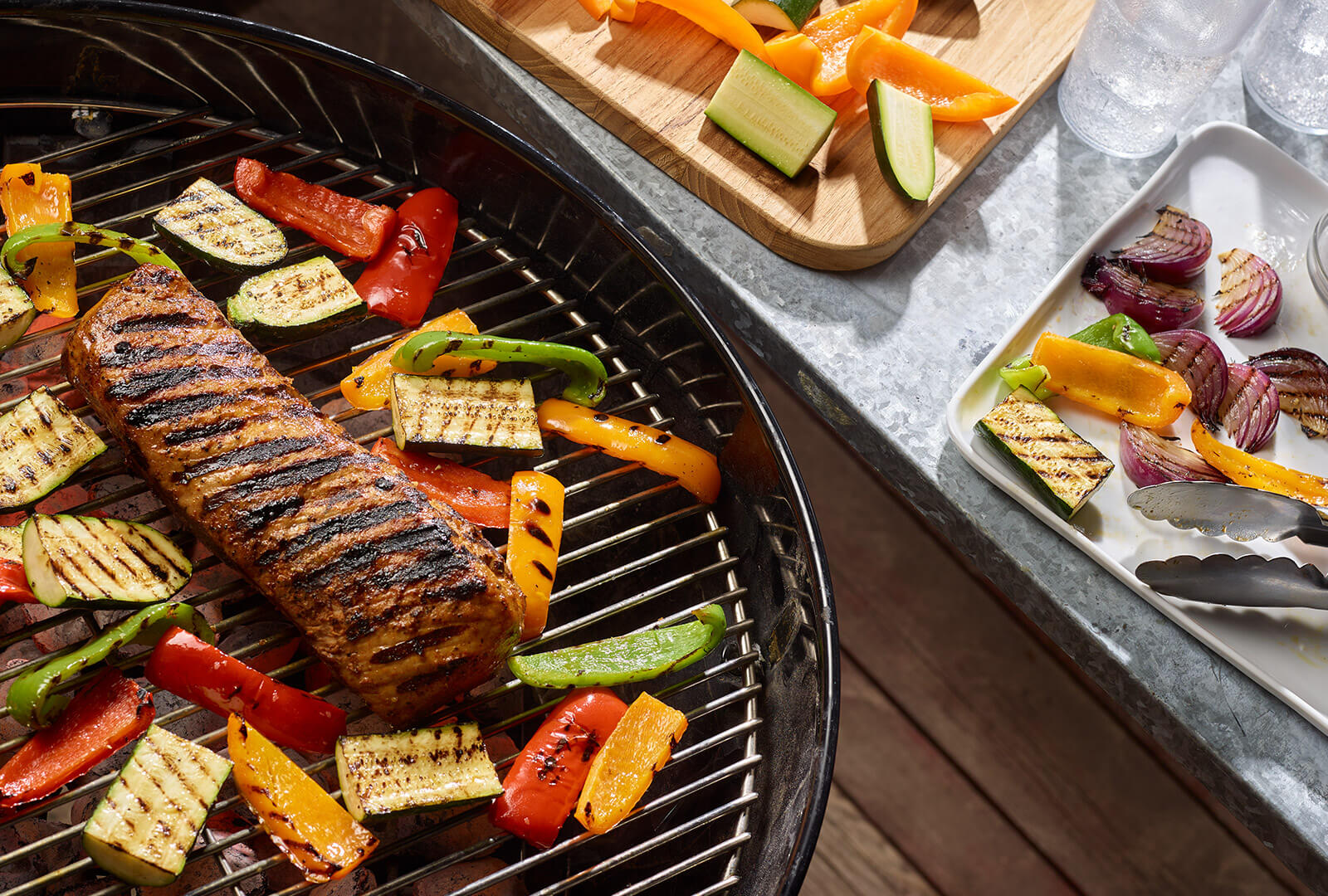 Grilled Pork Loin and vegetables on a grill