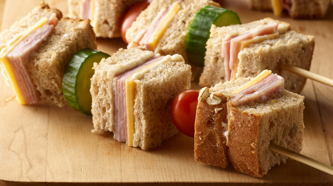 close up of sandwich served on a skewer