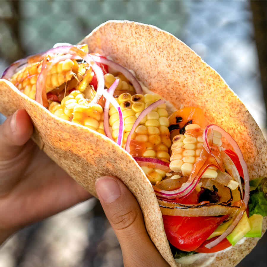 charred corn and red onion taco, technically an open-faced wrap, inside a whole wheat tortilla