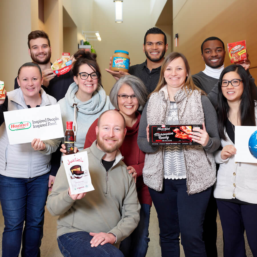 Hormel Foods employees holding a diverse set of products