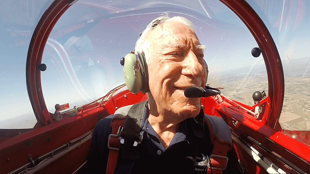 Chuck Baker flying in the same model plane he fly during World War 2 to celebrate his 100th birthday