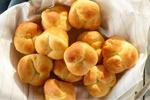 A basket full of cloverleaf rolls