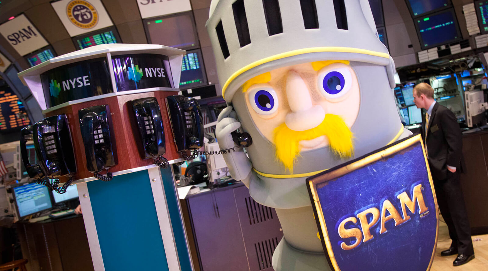 Sir Spam A Lot answering a phone at the NYSE