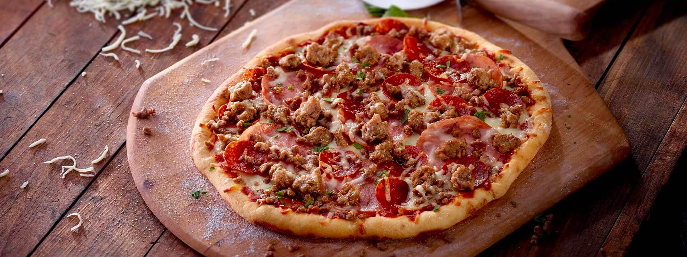 A pizza with sausage and meat