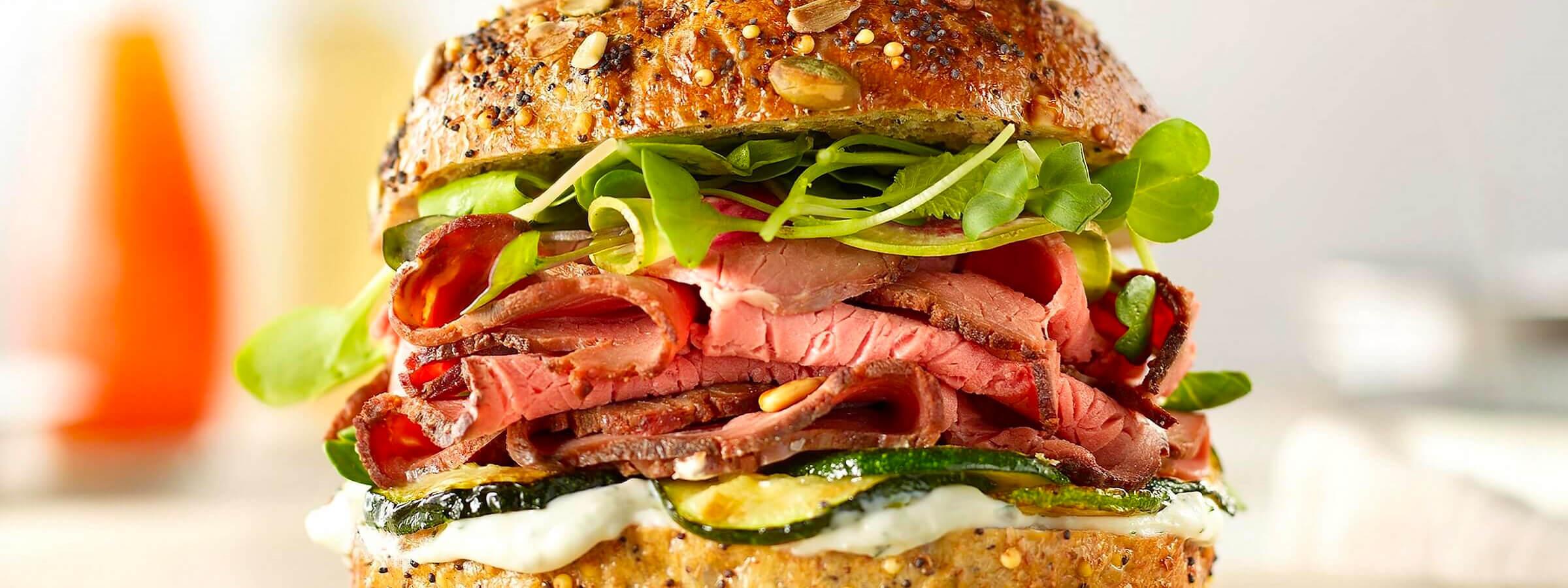 A closeup shot of a roast beef sandwich