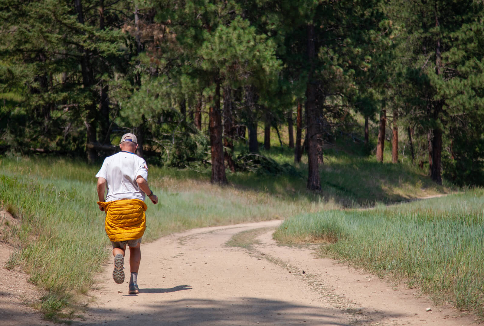 Kenneth Perry running down a path