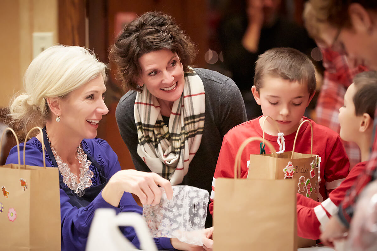 Mary Barinka and Sarah Erhert at the Hormel Historic Home Autism Holiday Party