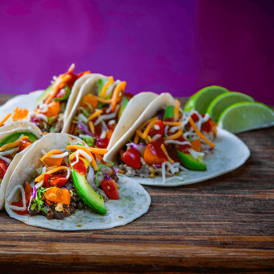 Some MegaMex tacos on a wood table