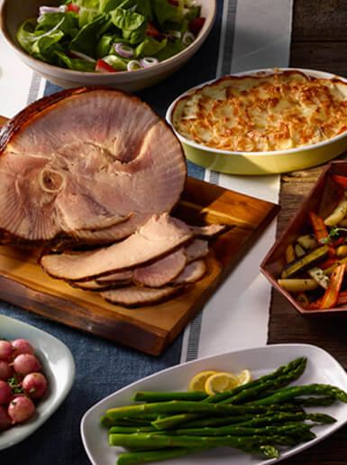 Ham with sides on table