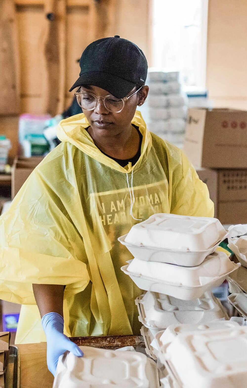 volunteer working to provide food